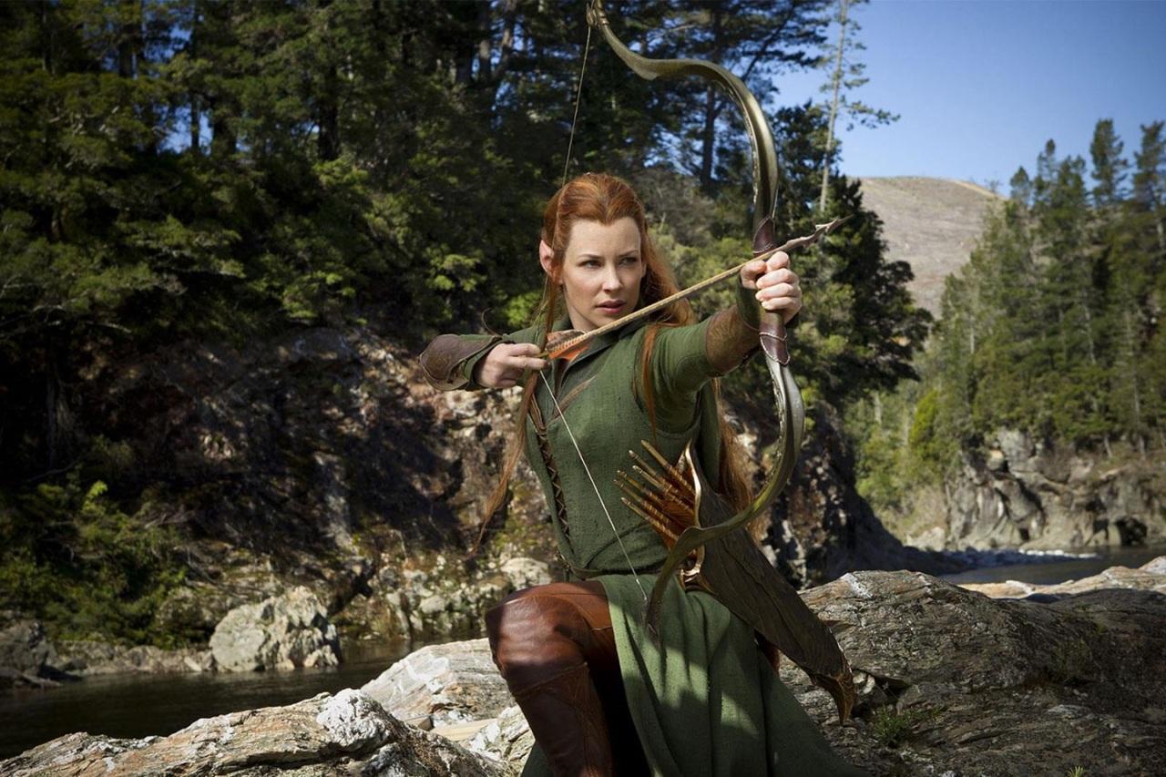 the.hobbit.the.desolation.of.smaug.movie.poster.o.hobbit.a.desolação.de.smaug.dragão.wallpaper.evangeline.lily.arqueira.archer.elf.elfa.atirando.flecha.arco