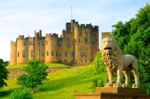 Alnwick Castle viewed from Lion Bridge. Alnwick Castle is a majestic medieval fortress dating from the 11th century and dominates the surrounding Northumberland landscape. It is the second largest occupied castle in England.